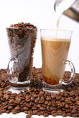 Making of caffe latte and coffee beans — Stock Photo