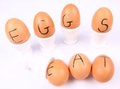 Eggs with an inscription EAT EGGS — Stock Photo