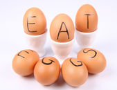 Eggs with an inscription EAT EGGS — Stock Photo