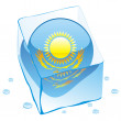 Kazakhstan button flag frozen in ice cub — Stock Vector