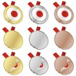 Japan vector flag in medal shapes — Stock Vector