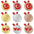 Turkey vector flag in medal shapes - Image vectorielle