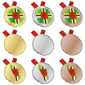 Dominica vector flag in medal shapes — Vettoriale Stock