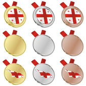 Georgia vector flag in medal shapes — Stock Vector