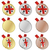 Sardinia vector flag in medal shapes — Vettoriale Stock