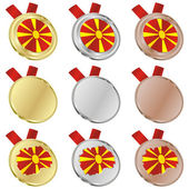 Macedonia vector flag in medal shapes — Stockvektor