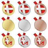 Denmark vector flag in medal shapes — Stockvektor