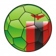 Zambia flag on soccer ball — Stock Vector