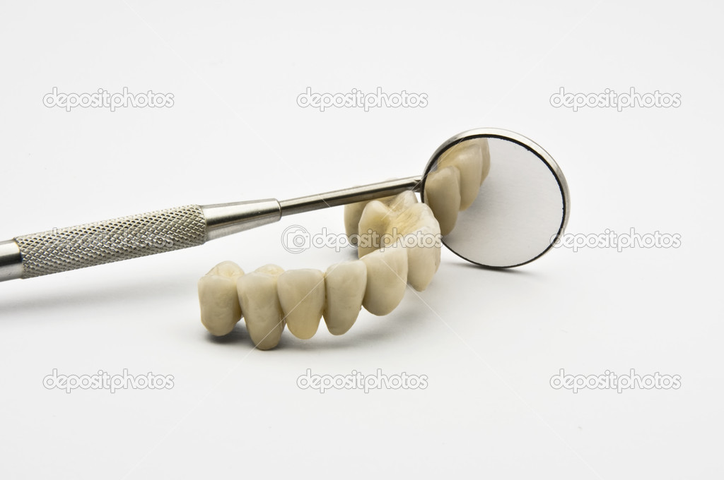 Dental prosthesis with Dental Mirror  on white background — Stock Photo #2986122