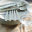 Stock Photo: Pile of metal forks on the white plates