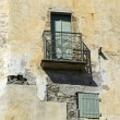 Old provence house with an iron balkony — Stock Photo