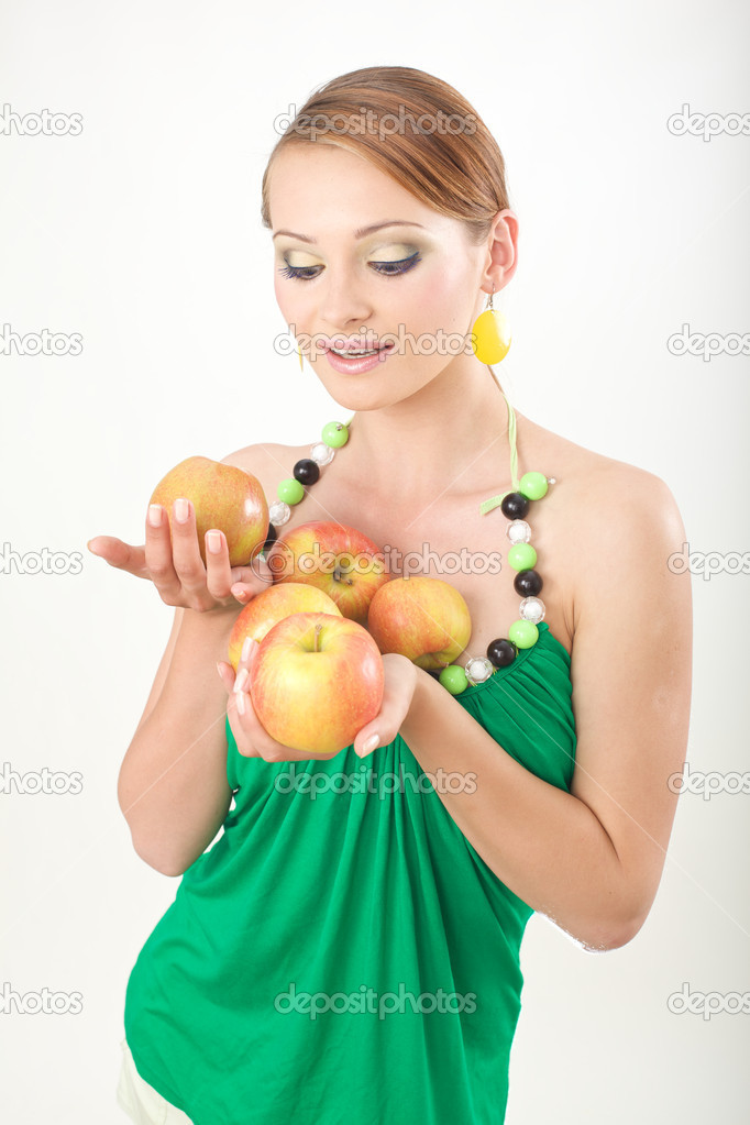 Girl in green sweater holding apples — Stock Photo #3065505