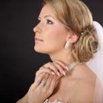 Beautiful bride, a blonde in the studio — Stock Photo