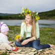 Стоковое фото: Beautiful young blonde sitting in the ga