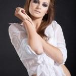 Beautiful young brunette in studio — Stock Photo
