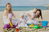 Happy mothers with children at the — Stock Photo