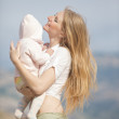 Beautiful young mom with a baby for a wa — Stock Photo #3173279