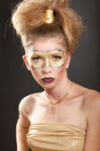 Girl with make-up art - a golden mask — Foto de Stock