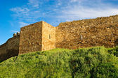 Wall and tower of genoese fortress — Stock Photo