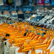 Clothes hangs on orange hangers — Stock Photo