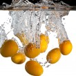 Stock Photo: Kumquats in water
