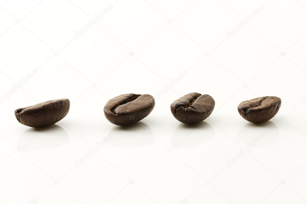 Closeup of four coffee beans on white background — Stock Photo #3054012
