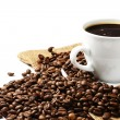 Coffee cup coffee beans and jute — Stock Photo #3516624