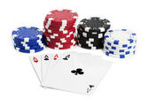 Four aces and chips on white — Stockfoto