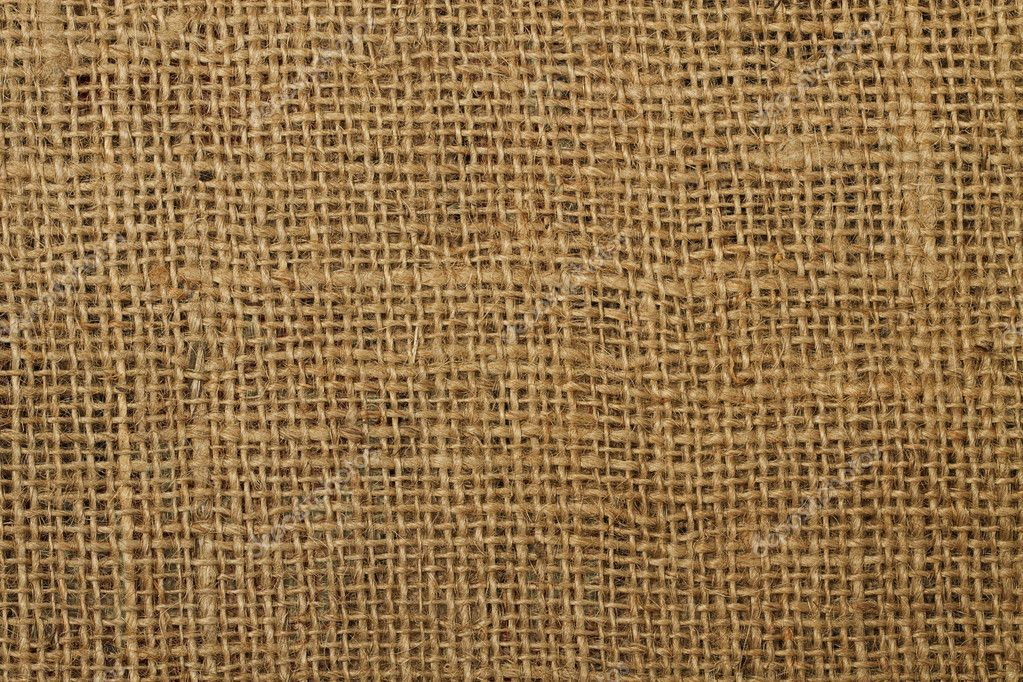 Background texture of an ancient brown jute material — Stock Photo #3516576