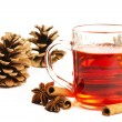 Red tea cinnamon sticks star anise and conifer cone - Stock Photo