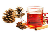 Red tea cinnamon sticks star anise and conifer cone — Stock Photo