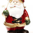 Red santa holding golden stars — Stock Photo