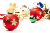 Red dull christmas ball and christmas ornaments in background — Stock Photo