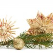 Two straw stars and christmas ball with branch — Stock Photo