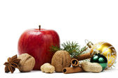 Apple anise nuts christmas balls and a branch — Stock Photo