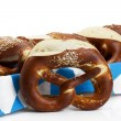 Pretzel in front of pretzels in a basket - Stock Photo