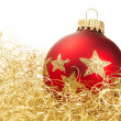 Red dull christmas ball in golden glitter cotton — Stock Photo #3810809