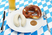 Bavarian veal sausage setup with beer from top — Stock Photo