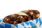 Some pretzels in a bread basket — Stok fotoğraf