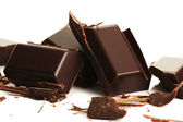 Broken plain chocolate pieces — Stockfoto