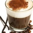 Coffee in a short glass with milk froth beans and vanilla — Stock Photo