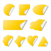 Yellow sticker in different shapes — Stock Vector