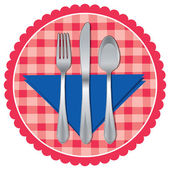 Spoon, fork and knife on a table cloth — Stock Vector
