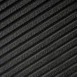 Black plastic surface, texture — Stock Photo