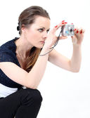 The attractive woman with digital camera — Stock Photo