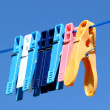 Cloth pegs with a under the blue sky — Stock Photo