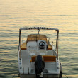 Backside of motorized boat with sunset — Stock Photo