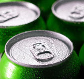 Green aluminum cans closeup with water drops. — Stock Photo