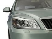 Motor-car Headlight and grate of radiator on a car — Stock Photo