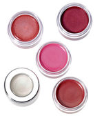 Multy-colored lip gloss in round silver plastic containers on wh — Stock Photo